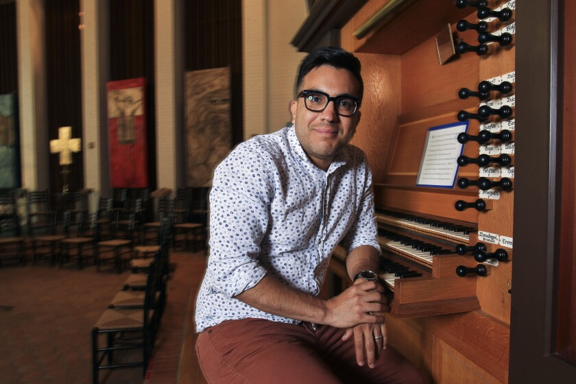 Ruben Valenzuela, the founder and director of the Bach Collegium San Diego, is shown at the organ in All Soul's Episcopal Church.