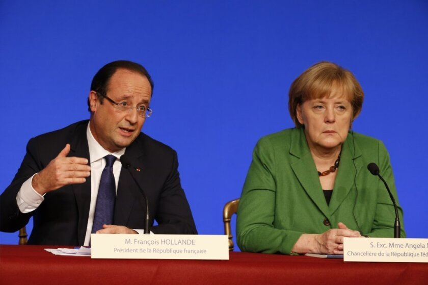 François Hollande, left, and Angela Merkel