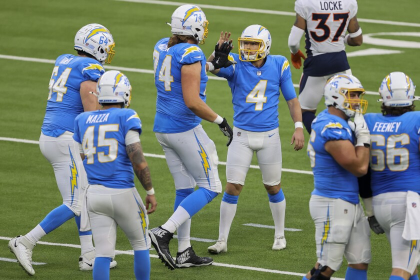Los Angeles Chargers kicker Michael Badgley (4) celebrates winning field goal Sunday against the Denver Broncos.
