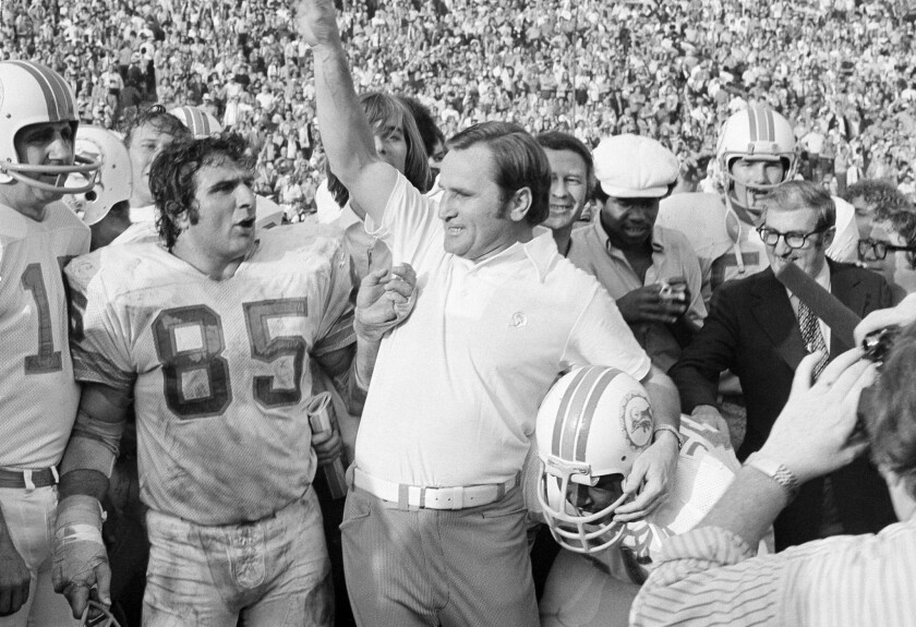 Dolphins Coach Don Shula celebrates as Miami defeats the Washington Redskins, 14-7, to complete their perfect 1972 season with a victory in Super Bowl VII.