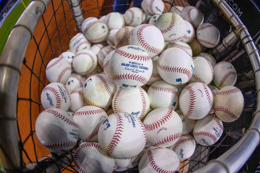 A basket full of baseballs.