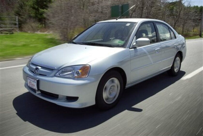 FILE - This April 25, 2002 file photo shows the Honda Civic Hybrid in Saco, Maine. More than 1 million vehicles in North America are part of a worldwide recall for an airbag problem affecting three big automakers. Toyota, Honda and Nissan are recalling more than 2 million vehicles because the inflator on the passenger side may burst, sending plastic pieces flying. Some of the vehicles being recalled are the Honda Civic, Toyota Corolla, Tundra and Lexus SC built between November 2000 and March 20