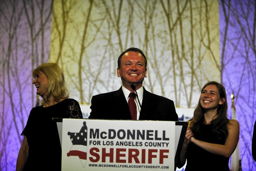 Long Beach Police Chief Jim McDonnell, shown with his wife, Kathy, and daughter, Megan, is widely seen as the frontrunner in the November runoff election for Los Angeles County sheriff.