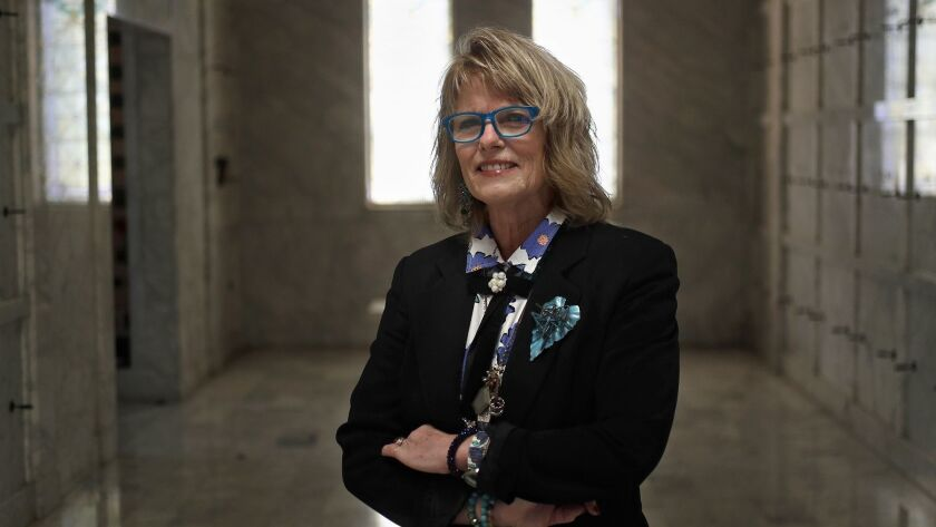 Jill Ann Lloyd, a funeral celebrant and service director, poses for a portrait in the mausoleum at F