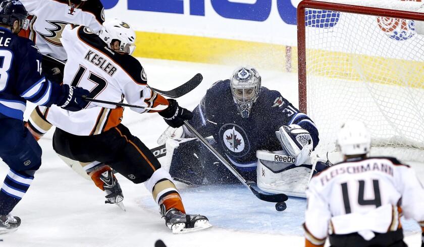 Ducks center Ryan Kesler slips a shot past Jets goaltender Ondrej Pavelec for one of his two goals in the third period of Game 4 on Wednesday night in Winnipeg.