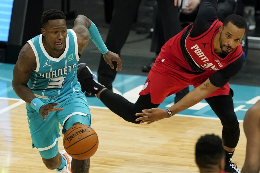 Charlotte Hornets guard Terry Rozier drives past Portland Trail Blazers forward Norman Powell during the second half in an NBA basketball game on Sunday, April 18, 2021, in Charlotte, N.C. (AP Photo/Chris Carlson)