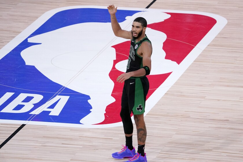 Boston Celtics' Jayson Tatum reacts during the second half of an NBA conference semifinal playoff basketball game against the Toronto Raptors Friday, Sept. 11, 2020, in Lake Buena Vista, Fla. The Celtics won 92-87. (AP Photo/Mark J. Terrill)