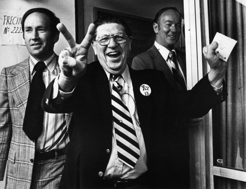 Howard Jarvis, chief sponsor of Proposition 13, signals victory as he casts his own vote at the Fairfax-Melrose precinct on June 6, 1978.
