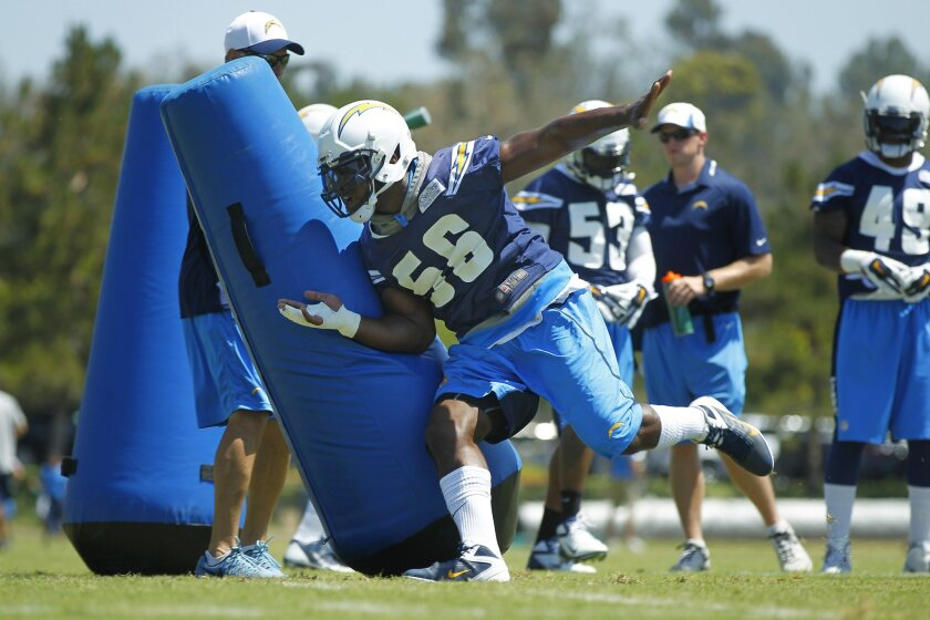 Chargers linebacker Donald Butler works out during practice.