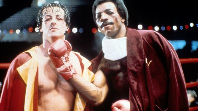 "Sylvester Stallone, left, and Carl Weathers on the set of ""Rocky"" in 1976."
