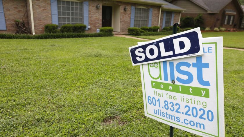 FILE- This April 23, 2018, file photo shows a sold sign in front of a home in Jackson, Miss. On Thur