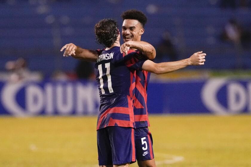 United States' Ricardo Pepi, left, celebrates scoring his side's second goal against Honduras
