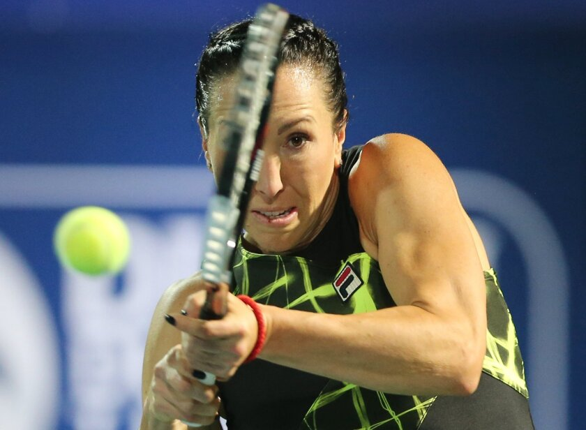 Jelena Jankovic from Serbia returns the ball to Belinda Bencic of Switzerland during the second day of the Dubai Tennis Championships in Dubai, United Arab Emirates, Tuesday, Feb. 16, 2016. (AP Photo/Kamran Jebreili)