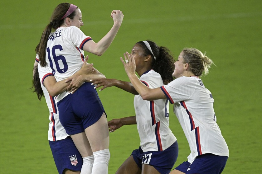 United States midfielder Rose Lavelle is congratulated by teammates.