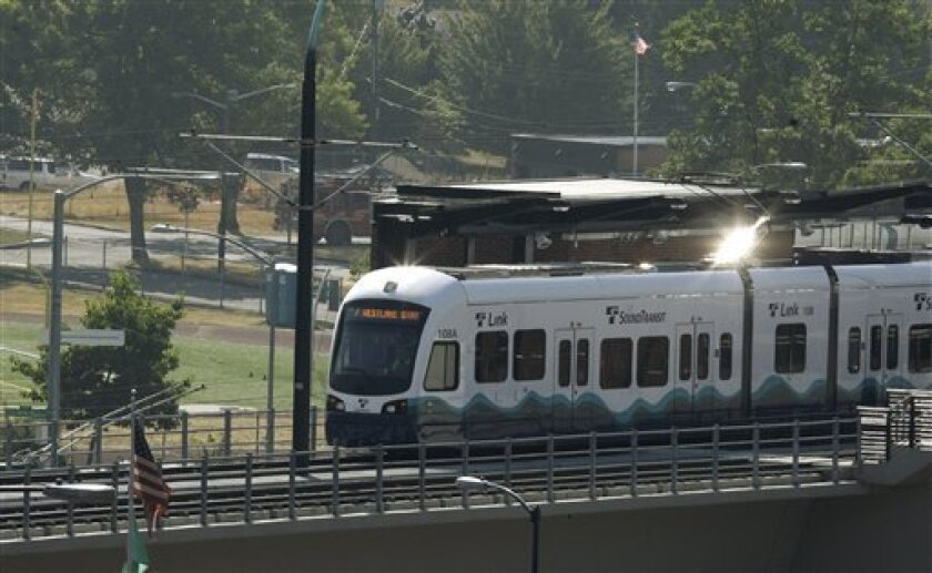 Sun reflects off of a Sound Transit light-rail train in Seattle. The rail line runs from downtown Seattle to near the Seattle-Tacoma International Airport.