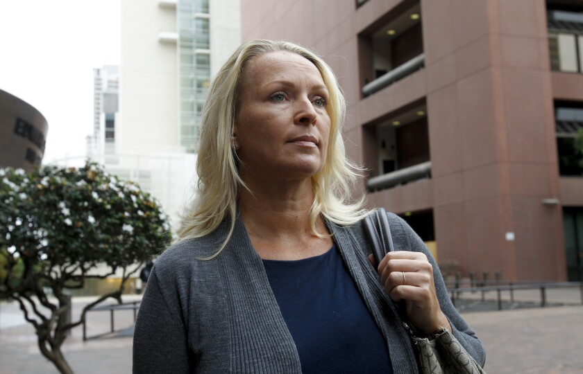 Margaret Hunter leaves federal court in San Diego where she and her husband, Congressman Duncan Hunter appeared for a status hearing. They are charged with misspending political donations on personal items.
