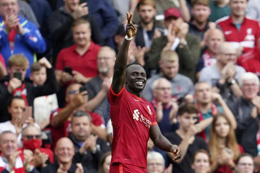 Liverpool's Sadio Mane celebrates after scoring the opening goal during the English Premier League soccer match between Liverpool and Crystal Palace at Anfield Stadium, Liverpool, England, Saturday Sep. 18, 2021. (AP Photo/Jon Super)