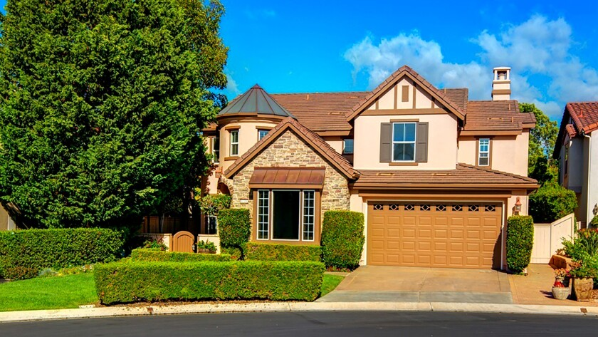 SAN MARCOS: A sweeping staircase ascends to a master suite with a balcony in this upgraded cul-de-sa