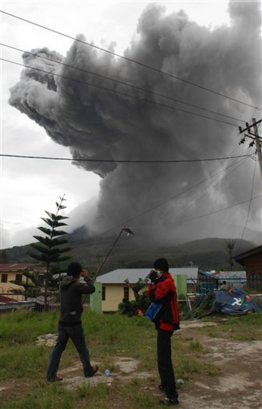Mount Sinabung spews volcanic materials into the sky as seen from Tanah Karo, North Sumatra, Indonesia, Friday, Sept. 3, 2010. (AP Photo/Dedy Zulkifli)