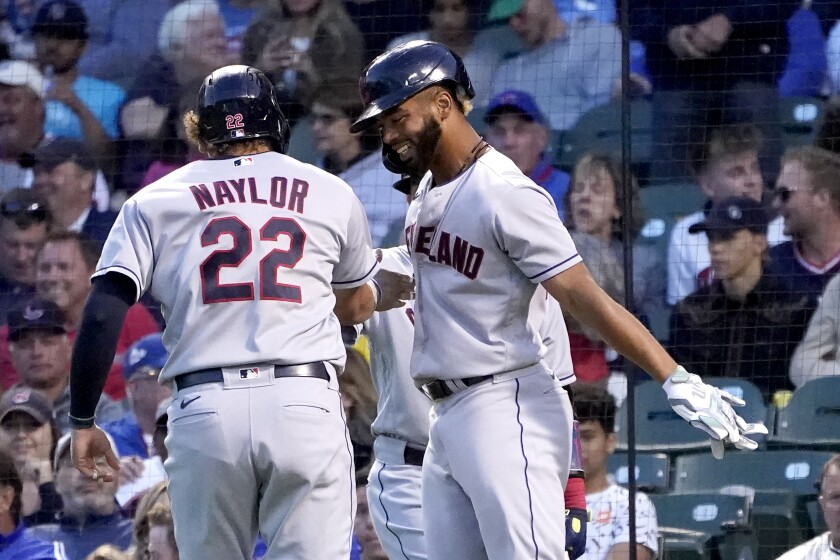 Cleveland Indians' Bobby Bradley, right, celebrates with Josh Naylor after they scored on Naylor's two-run home run off Chicago Cubs starting pitcher Albert Alzolay during the fifth inning of a baseball game Monday, June 21, 2021, in Chicago. (AP Photo/Charles Rex Arbogast)