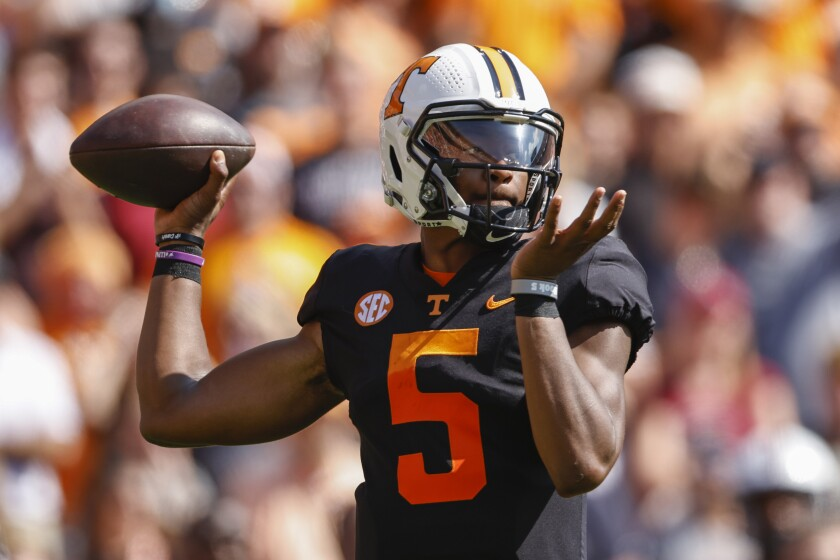 Tennessee quarterback Hendon Hooker (5) throws to a receiver during the first half of an NCAA college football game against South Carolina, Saturday, Oct. 9, 2021, in Knoxville, Tenn. (AP Photo/Wade Payne)