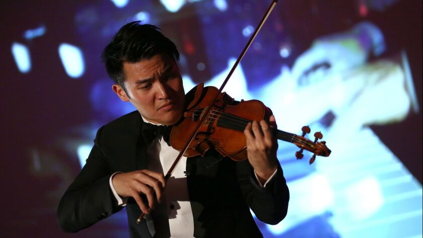 Violinist Ray Chen performing in London on June 2, 2014.