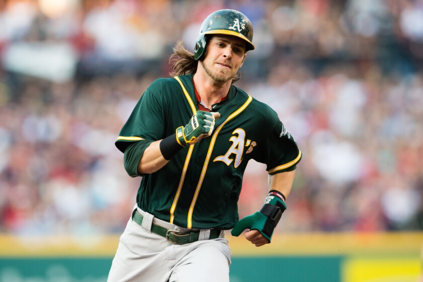 Josh Reddick rounds second for Oakland against Cleveland on July 30.