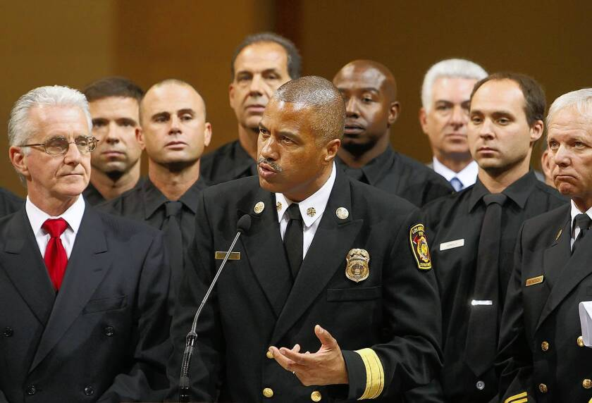 """Fire Chief Brian Cummings, center, addresses the City Council. """"I've not seen enough movement"""" at the Fire Department, Mayor Garcetti told reporters Thursday."""