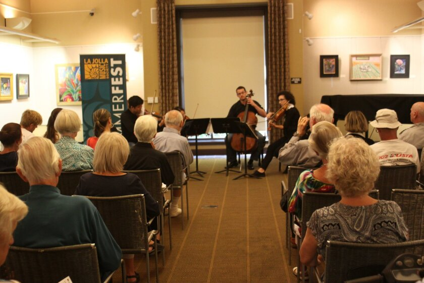 The community room at La Jolla's Riford Library is packed for the inaugural La Jolla Music Society SummerFest Coaching Workshop concert, Aug. 3.
