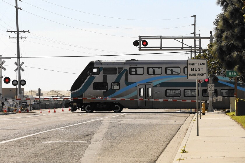 A Metrolink train moves through the Rice Avenue crossing in Oxnard one day after another Metrolink train derailed after hitting a truck stalled on the railroad tracks.