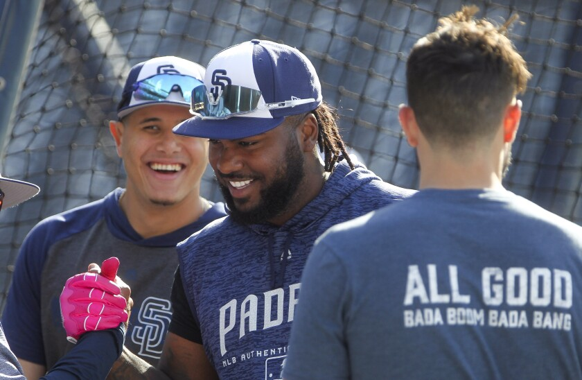 The Padres' Franmil Reyes, center, Eric Hosmer, right, and Manny Machado stand together during batting practice before the Padres play the Diamondbacks on Tuesday.