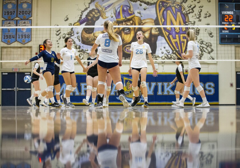 The Marina girls' volleyball team celebrates a point against Pacifica during a nonleague match on Wednesday.