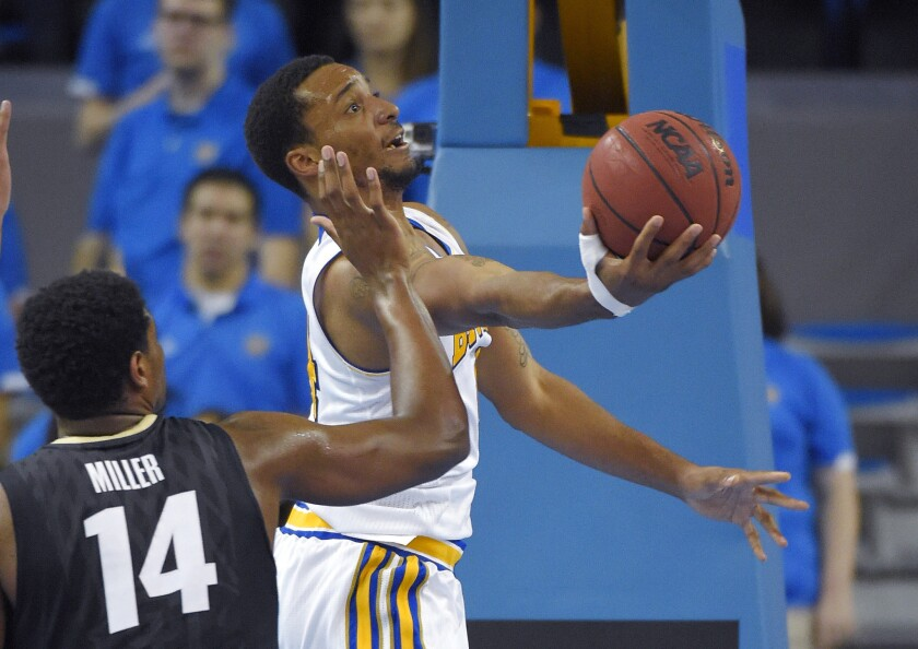 UCLA guard Normal Powell puts up a shot as Colorado forward Tory Miller defends during the Bruins' 72-59 win Saturday over the Buffaloes.