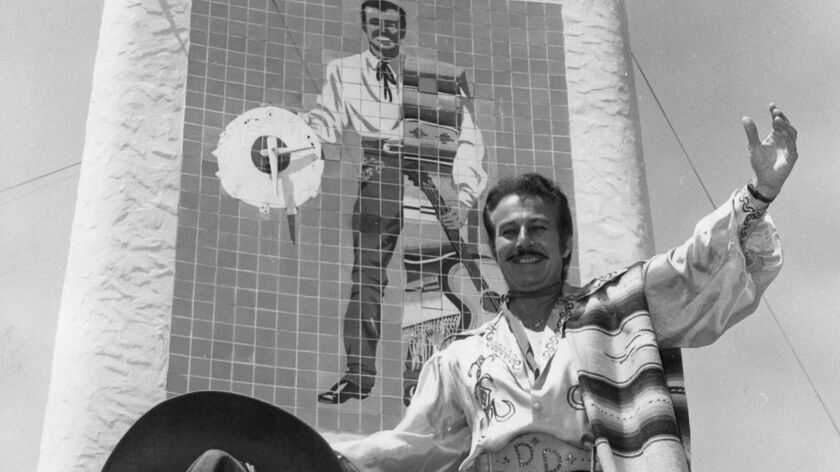 Tommy Hernandez, dressed as the San Diego County Fair's former ambassador Don Diego, stands before the clock tower at the Del Mar Fairgrounds in this undated photo.