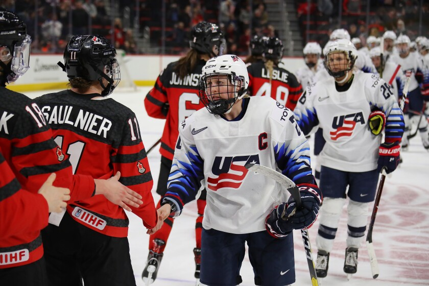 Kendall Coyne Schofield of the United States shakes hands with Canadian players after a 2-0 loss in Detroit on Feb. 17, 2019.