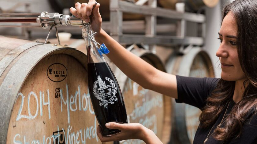 Wine on tap, straight from the barrel, is poured into growlers to take home at LJ Crafted Wines in Bird Rock.
