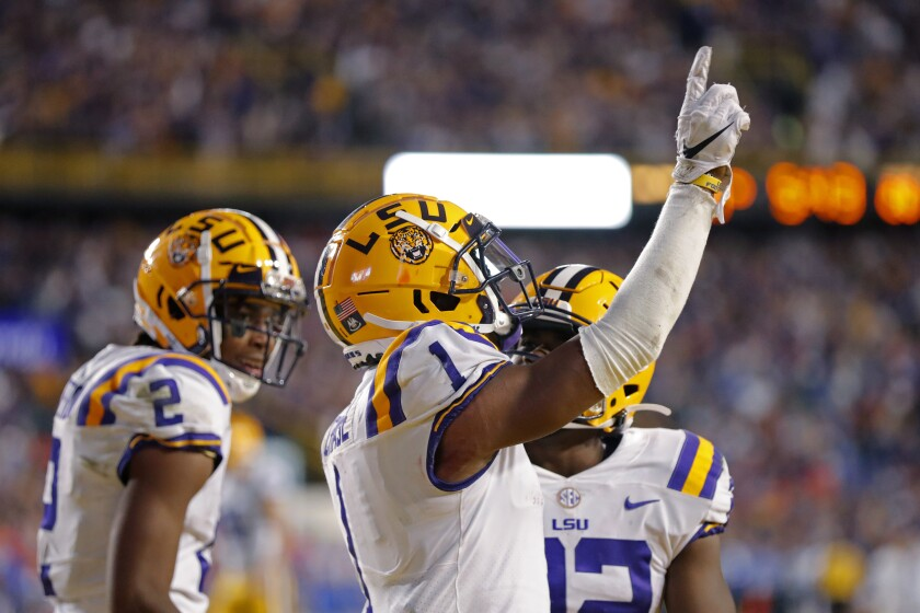 LSU wide receiver Ja'Marr Chase (1) celebrates his touchdown reception in the second half Saturday.