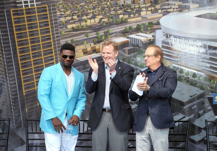 LaDainian Tomlinson, left, NFL commissioner Roger Goodell and Chargers chairman Dean Spanos stand on stage during the Chargers citizens' initiative rally.