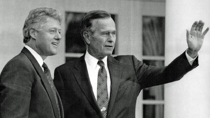 11/18/92--President George H.W. Bush waves as President-elect Bill Clinton stands alongside Wednesda