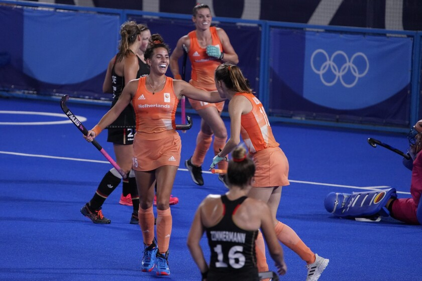 Netherlands' Frederique Matla (15) celebrates with her teammates after scoring during a women's field hockey match against Germany at the 2020 Summer Olympics, Saturday, July 31, 2021, in Tokyo, Japan. (AP Photo/John Locher)