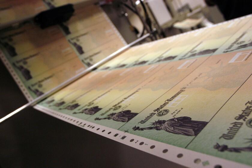 Blank Social Security checks are run through a printer at the U.S. Treasury printing facility in Philadelphia in 2005.