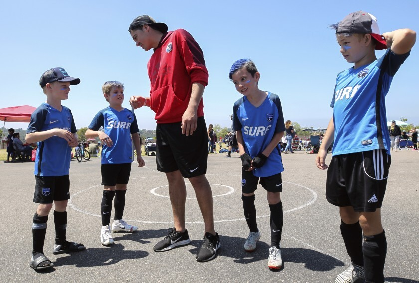 "San Diego Sockers goalie Boris Pardo talks to members of The Blues soccer team during the ""Goals for Lives"" soccer tournament at Sycamore Ridge Elementary in Carmel Valley on June 8. The event raised money to help find a cure for a rare cancer that targets children."