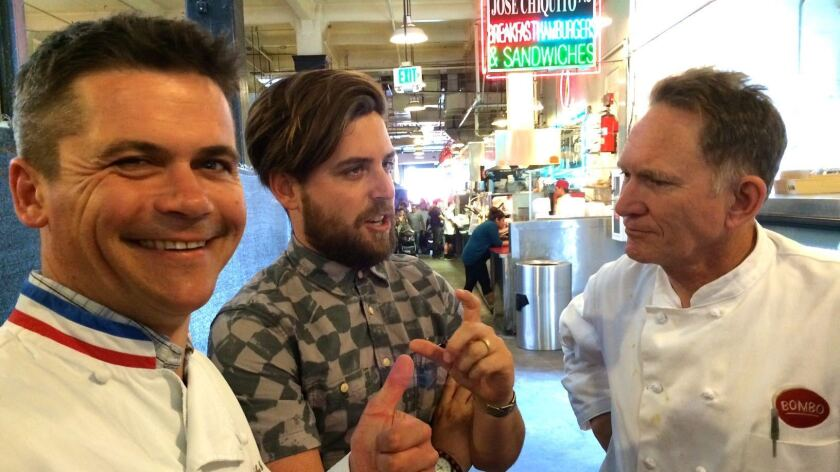 Rodolphe Le Meunier, left, Alex Brown of Hot Knives and chef Mark Peel at Grand Central Market.