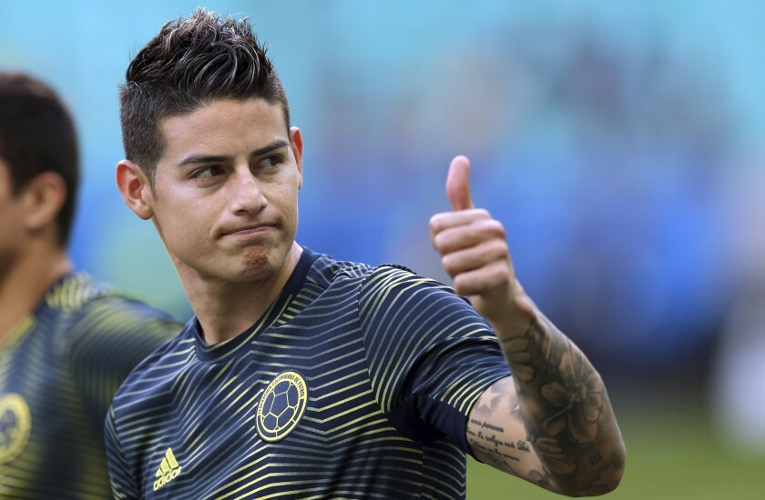 FILE - In this Sunday, June 23, 2019 file photo, Colombia's James Rodriguez gives a thumbs up before a Copa America Group B soccer match against Paraguay at Arena Fonte Nova in Salvador, Brazil. James Rodriguez joined Premier League club Everton on Monday, Sept. 7, 2020 in an attempt to revive a career that faltered at Real Madrid. Signed by the Spanish giants after capturing world football with a stunning goal for Colombia at the 2014 World Cup, Rodriguez couldn't match those highs in Madrid. (AP Photo/Ricardo Mazalan, file)