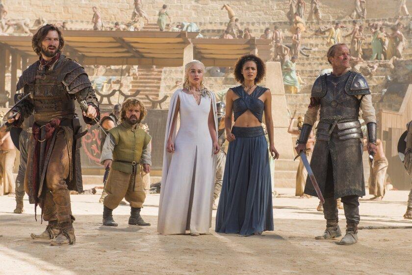 "Michiel Huisman, Peter Dinklage, Emilia Clarke, Nathalie Emmanuel, and Iain Glen, in a scene from ""Game of Thrones,"" season 5."