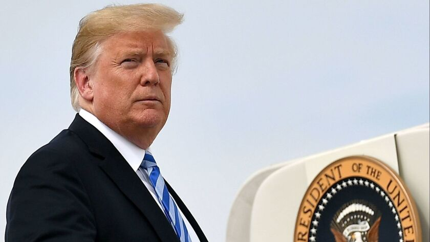 """President Trump, seen boarding Air Force One, said on Aug. 23, """"I will tell you what, if I ever got impeached, I think the market would crash. I think everybody would be very poor."""""""