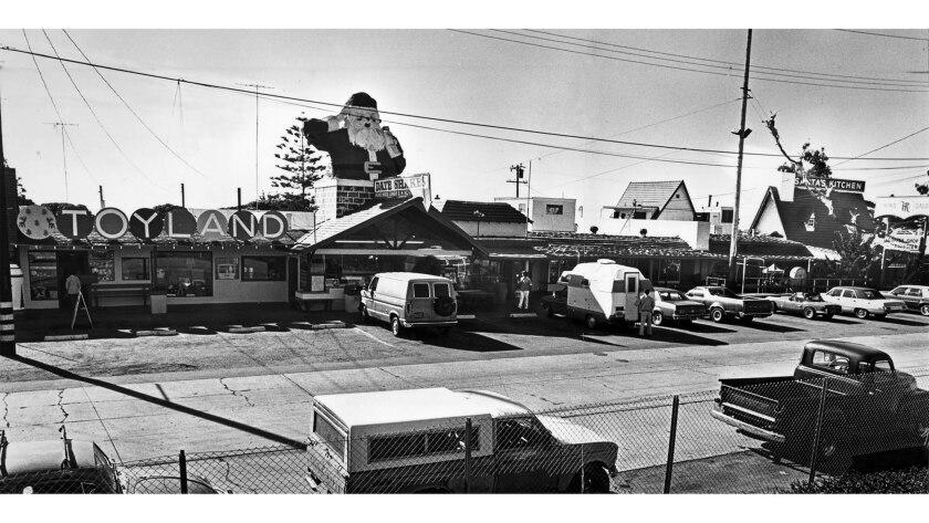 Dec. 15, 1980: The 15-foot-tall Santa sits atop the candy shop at Santa Claus Lane, a small strip of
