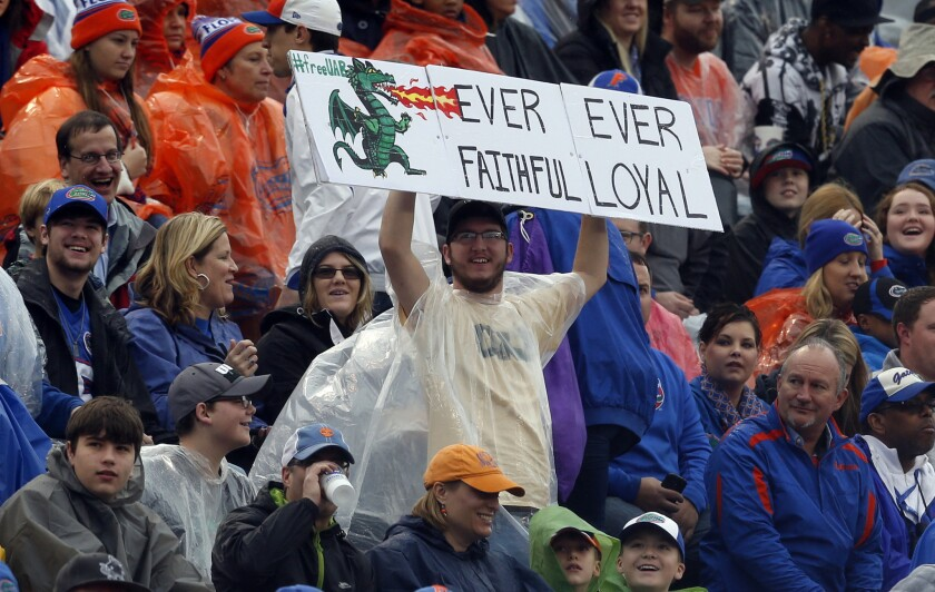 A UAB football fan declares his loyalty to the terminated football program during the Birmingham Bowl game between Florida and East Carolina on Jan. 3, 2015.