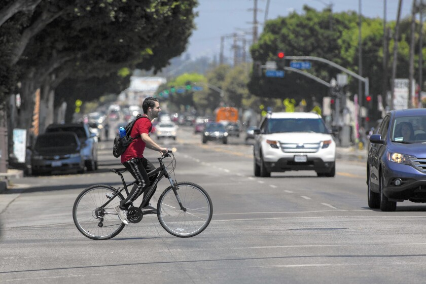 Cyclists ride along North Figueroa Street between Avenue 52 and Avenue 56 in Highland Park. Councilman Gil Cedillo enraged bike activists last year when he put off plans for a bike lane on Figueroa.