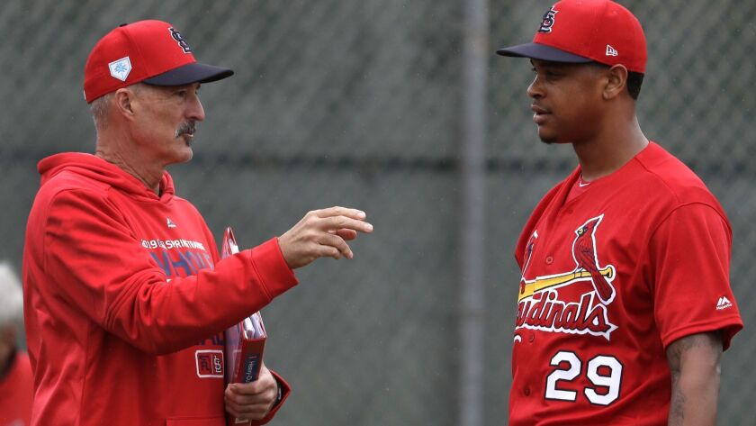 St. Louis Cardinals pitching coach Mike Maddux, left, talks with pitcher Alex Reyes during spring tr